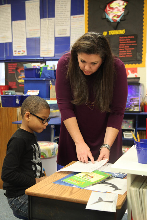 ms. childs helping a student