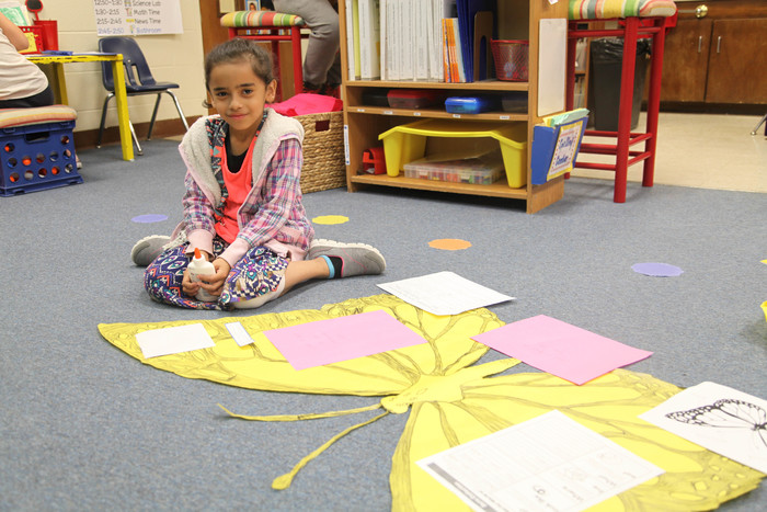 student drawing a butterfly