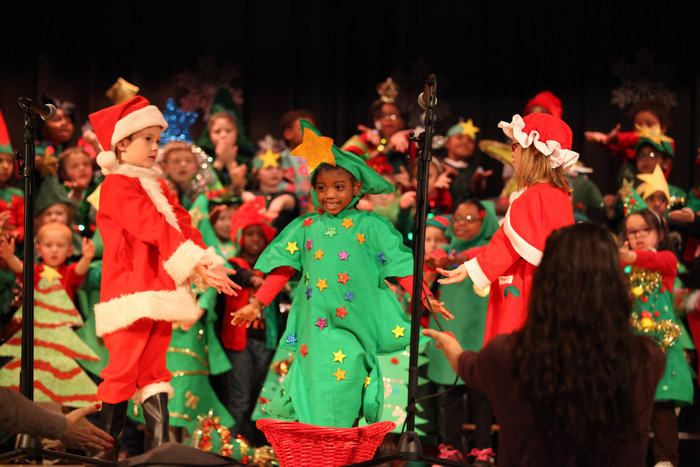 "three students performing in ""The Littlest Christmas Tree"" musical"