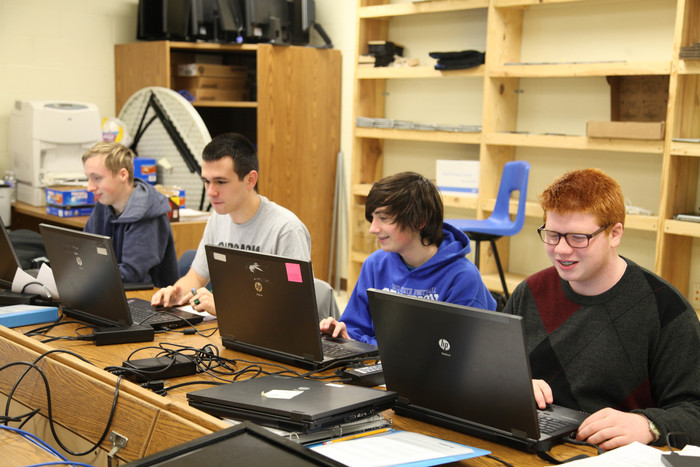 Four students working on the CyberPatriot State Competition