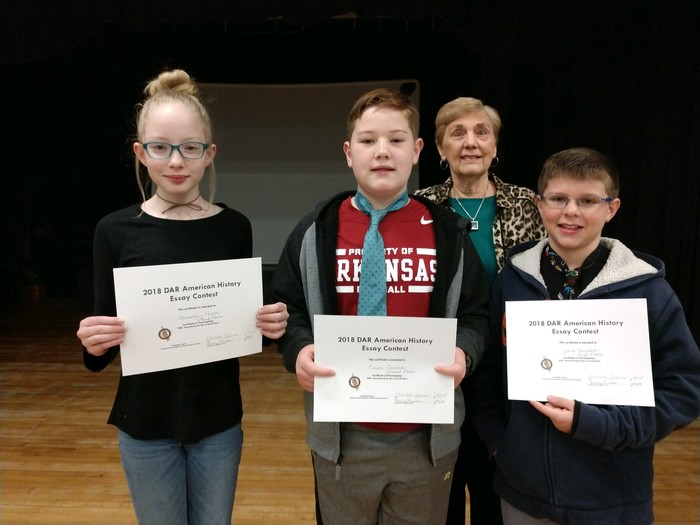 DAR essay contest winners with presenter