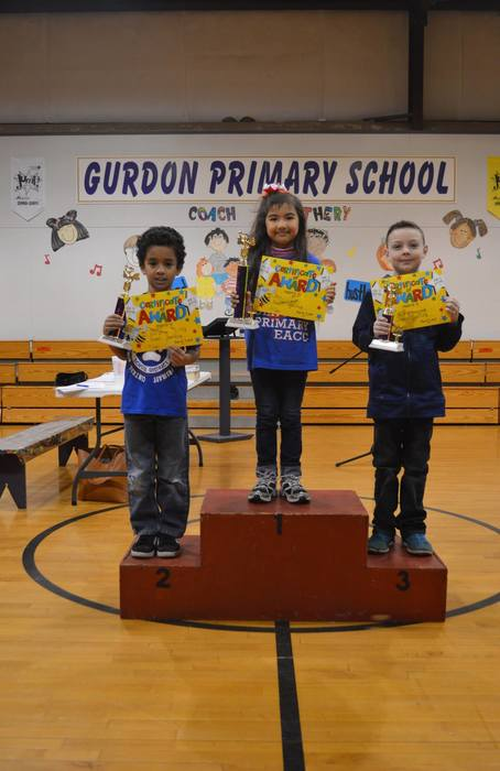 Central spellers pose with spelling bee trophy