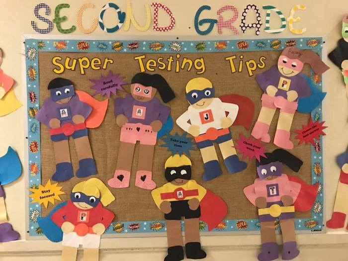 teacher billboard with superheroes for testing