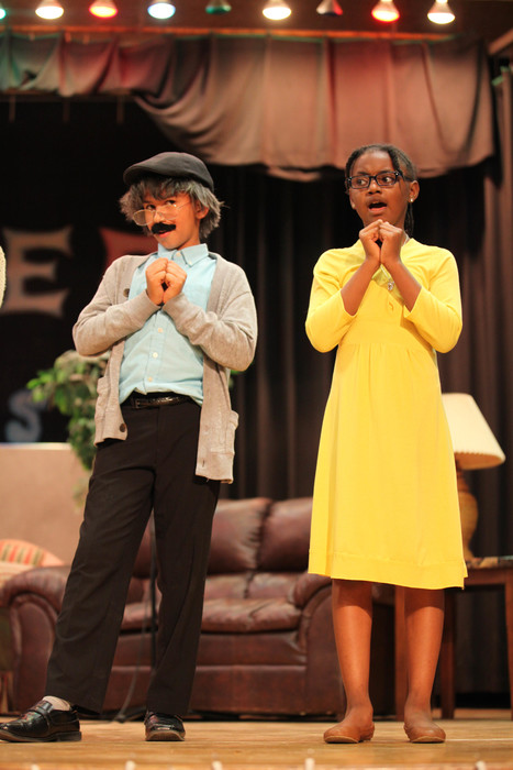 two students performing in musical