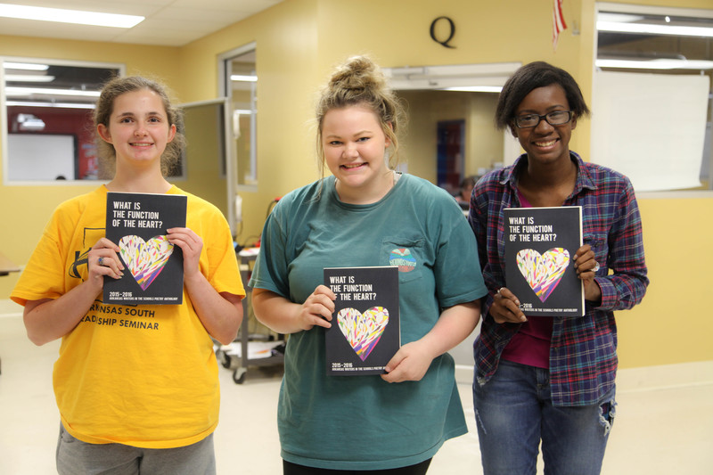 Students holding poetry anthologies