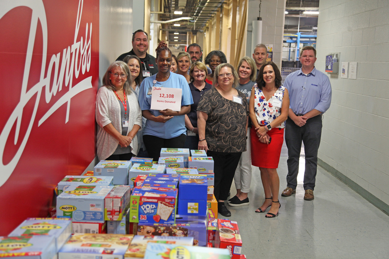 PFCU/Danfoss Back to School Food Drive Nets  Over 12,000 Items for APS Students